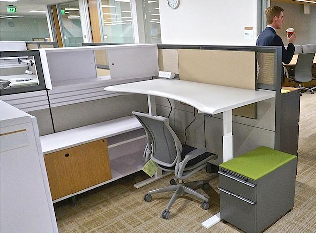 Every desk in the new offices is electronically adjustable.