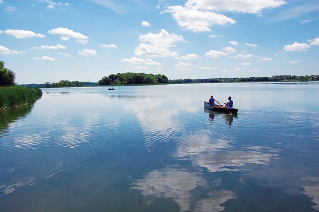 A Vinland Staff member canoeing with clients on Lake Independence.