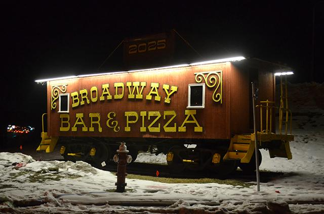 You can recognize Broadway Pizza by the old rail car they use as a landmark on t