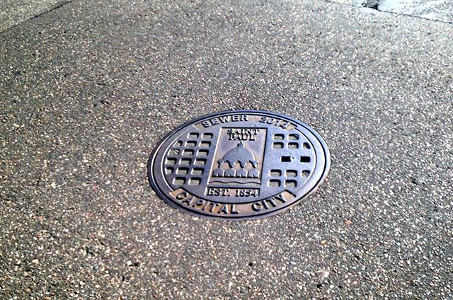 A cast-iron sewer cover from 2014 in Saint Paul's West End neighborhood.