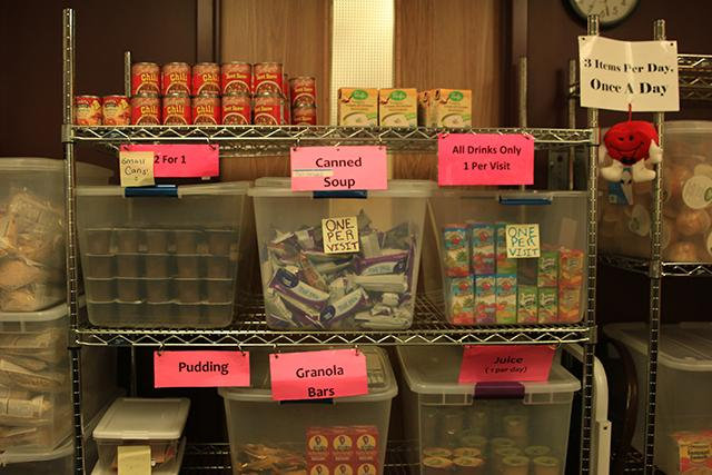 a photo of nonperishable food stacked on shelves