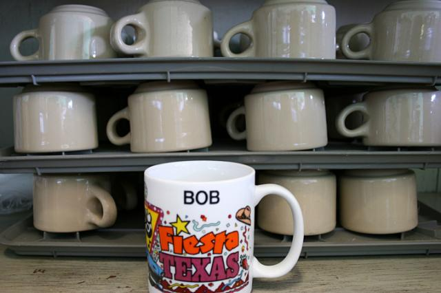 Original coffee cups and Bob Sanger's special cup are stacked under the lunch co