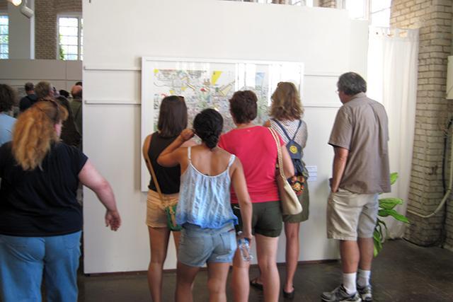 people admiring works