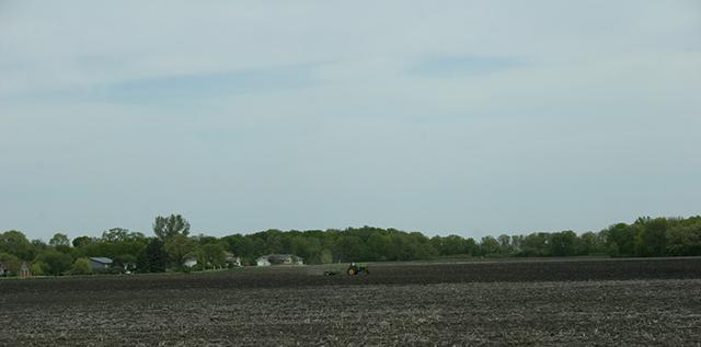 Field work, John Deere in field west of New Ulm