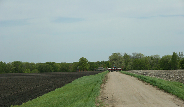 Field work, tractor on drive, west of New Ulm