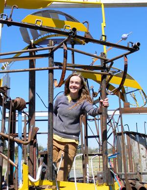 Bridget Beck with her sculpture at the Franconia Sculpture Park
