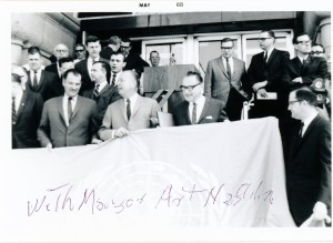 Elmer L. Andersen  (center), Mayor Arthur Naftalin (right) and unidentified person with the UN flag before raising May 1, 1968