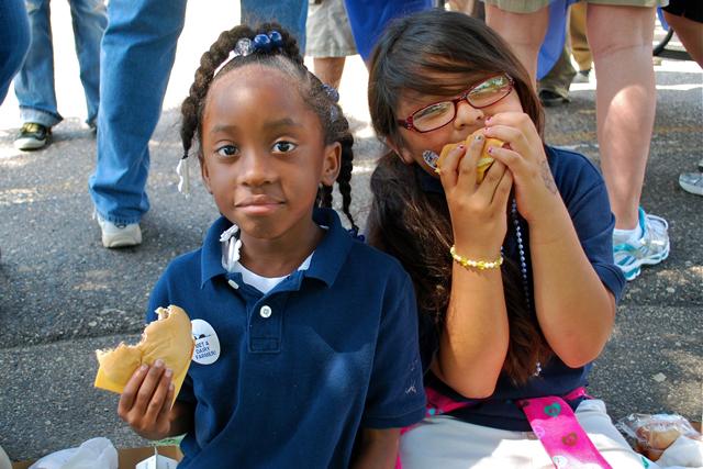 First graders Talaya Davis and Citlally Cortez WhiteEagle enjoy cheeseburgers provided by the Morris FFA Alumni