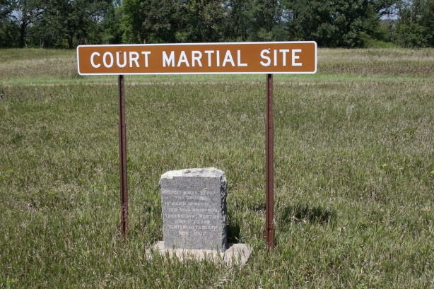 The message on a marker near the Lower Sioux Agency reads: 75 feet north stood the building in which upwards of 100 Sioux Indians were tried by court martial, convicted and sentenced to death Nov. 1862.