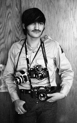 photo of mike evangelist with cameras slung around his neck