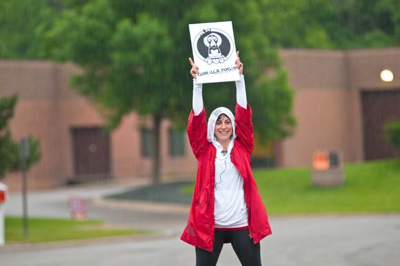 Jessica Rosenberg hoists a Gorilla logo high.