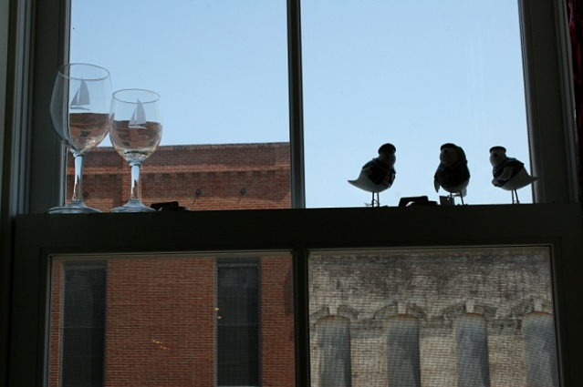 wineglasses and birds in a window