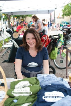 Kate Ostheimer, Linden Hills' market manager, sells teeshirts with the market's logo.