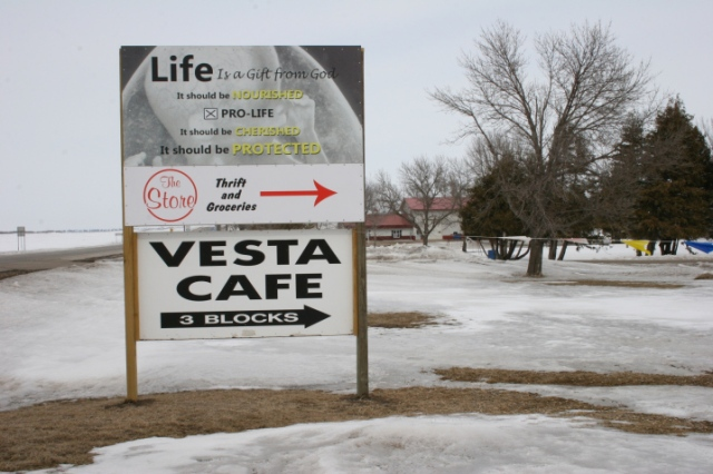 This sign by the thrift store points travelers along Minnesota Highway 19, left, to The Store and the Vesta Cafe.