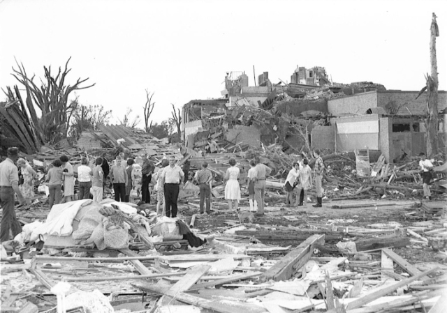 Surveying the destruction at Tracy Elementary School, which was destroyed. Photo by The Tracy Headlight Herald and courtesy of Scott Thoma.