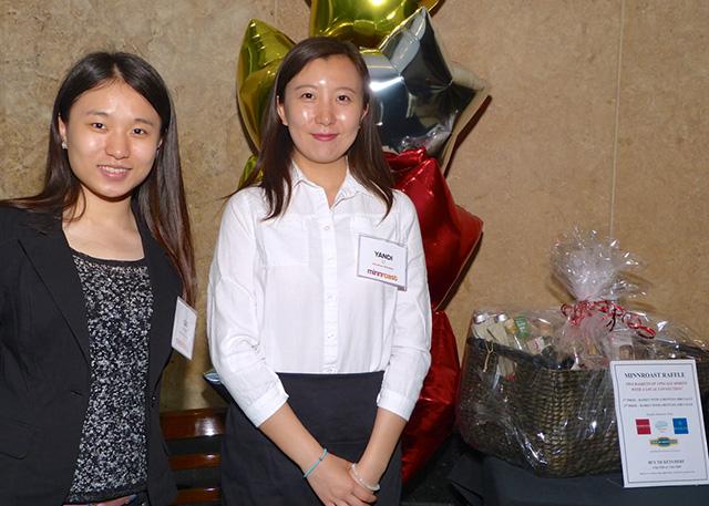 MinnRoast volunteers Sai Wang and Yandi Li