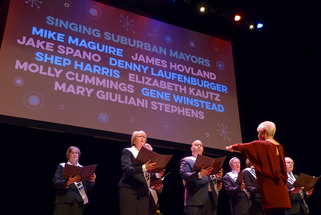 The Singing Suburban Mayors being conducted by DeAnne Sherman